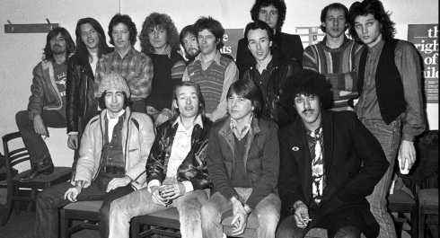 The Summit launch for the benefit album: Back row - Boz Burrell ( Bad Co), Scott Gorham ( Thin Lizzy), Eric Clapton, Plant, one of ELO, Pik Withers from Dire Straits, Brian Downey from Thin Lizzy in front, John Illsley (Dire Straits) behind, Mark Knopfler ( Dire Straits) David Knopfler ( DS)   Front Row - Paul Rodgers, Simon Kirke and Mick Ralphs from Bad Co, Phil Lynott from Thin Lizzy.